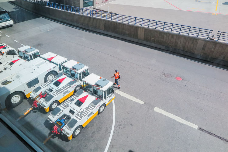 Transport maintenance at the airport Transportation Occupation High Angle View Working Road Real People Mode Of Transportation Day Men Land Vehicle People Standing Safety Protection Industry Motor Vehicle Street Sign Car Outdoors