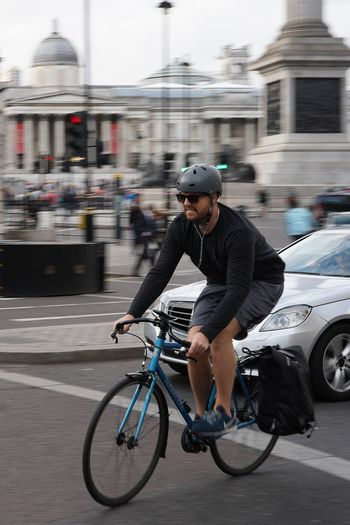 Cyclist in Trafalgar Square One Person Mode Of Transport Transportation One Man Only Bicycle Headwear Mobility In Mega Cities Cycling Lifestyles Blurred Motion Motion City