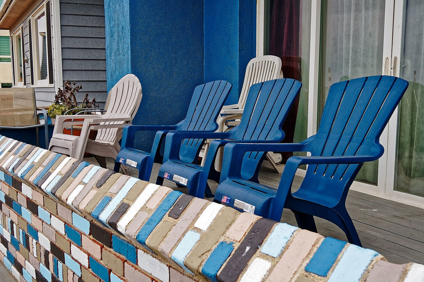 Architecture Arrangement Blue Building Exterior Built Structure Chair Day Empty Folding Chair Hermosa In A Row No People Outdoors Pacific Ocean Seat Table Wood - Material