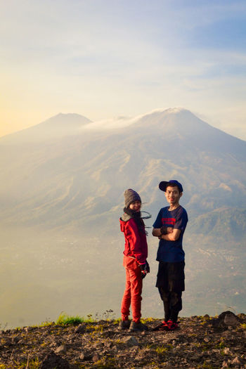 Togetherness Mountain Leisure Activity Males  Women Boys People Beauty In Nature Childhood Full Length Two People Child Standing Sky Real People Nature Scenics - Nature Men Females Family Mountain Range Sister Outdoors Positive Emotion
