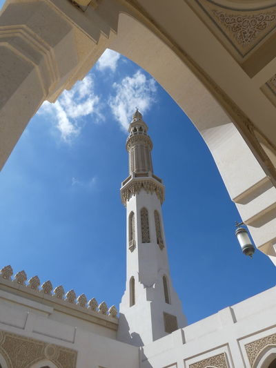View of Minaret within Mosque opposite The Royal Palace, Dubai, United Arab Emirates 2019 Dubai UAE 2019 Mosque Islam Religion Minaret Blue Sky Sunlight And Shade Spirituality Belief Place Of Worship No People Tower Place Of Prayer Low Angle View Arabic Architecture Arch Full Frame Composition Outdoor Photography Symbolism Tourist Attraction  Travel Destinations Architecture