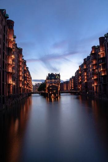 Buildings lit up at dusk