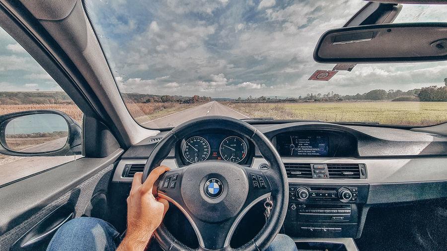 Person seen through car windshield