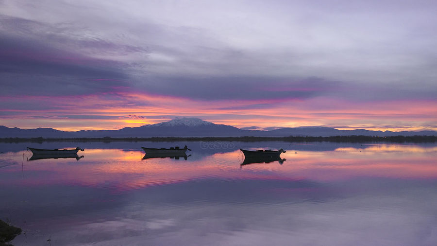 Canigou Canigou Mountain Cloud - Sky Reflection Sunset Sky Water Beauty In Nature Scenics - Nature Orange Color Lake Nature Tranquility No People Tranquil Scene Standing Water Transportation Dramatic Sky Waterfront Outdoors Non-urban Scene Lagoon