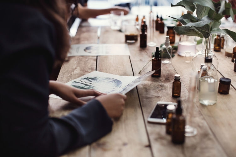 Midsection of woman holding drink at restaurant