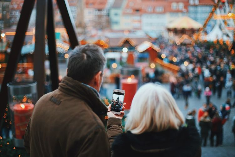 Rear view of people photographing during christmas