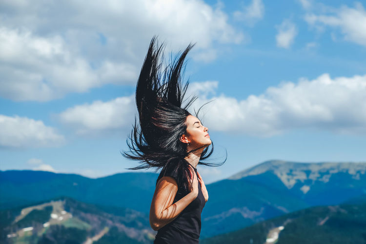 Sky Mountain Cloud - Sky One Person Beauty In Nature Real People Leisure Activity Lifestyles Nature Hairstyle Long Hair Hair Women Mountain Range Young Adult Day Non-urban Scene Young Women Adult Tousled Hair Outdoors Hair Toss Wind
