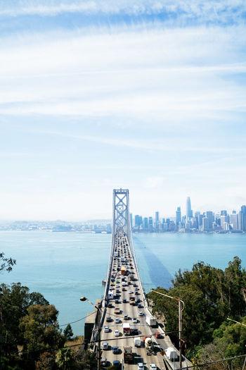 View of bridge over sea against buildings
