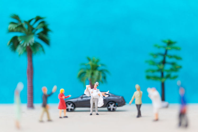 Miniature people, Bride and groom on the beach Celebration Couple Groom Happiness Happy Husband Love Married Wedding Beach Bride And Groom Day Honymoon Marriage  Miniature Nature Outdoors People Ralationship Ramonce Sand Summer Togetherness Tree Women