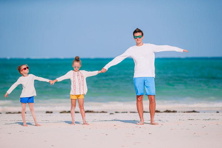 Full length of boy on beach against sky
