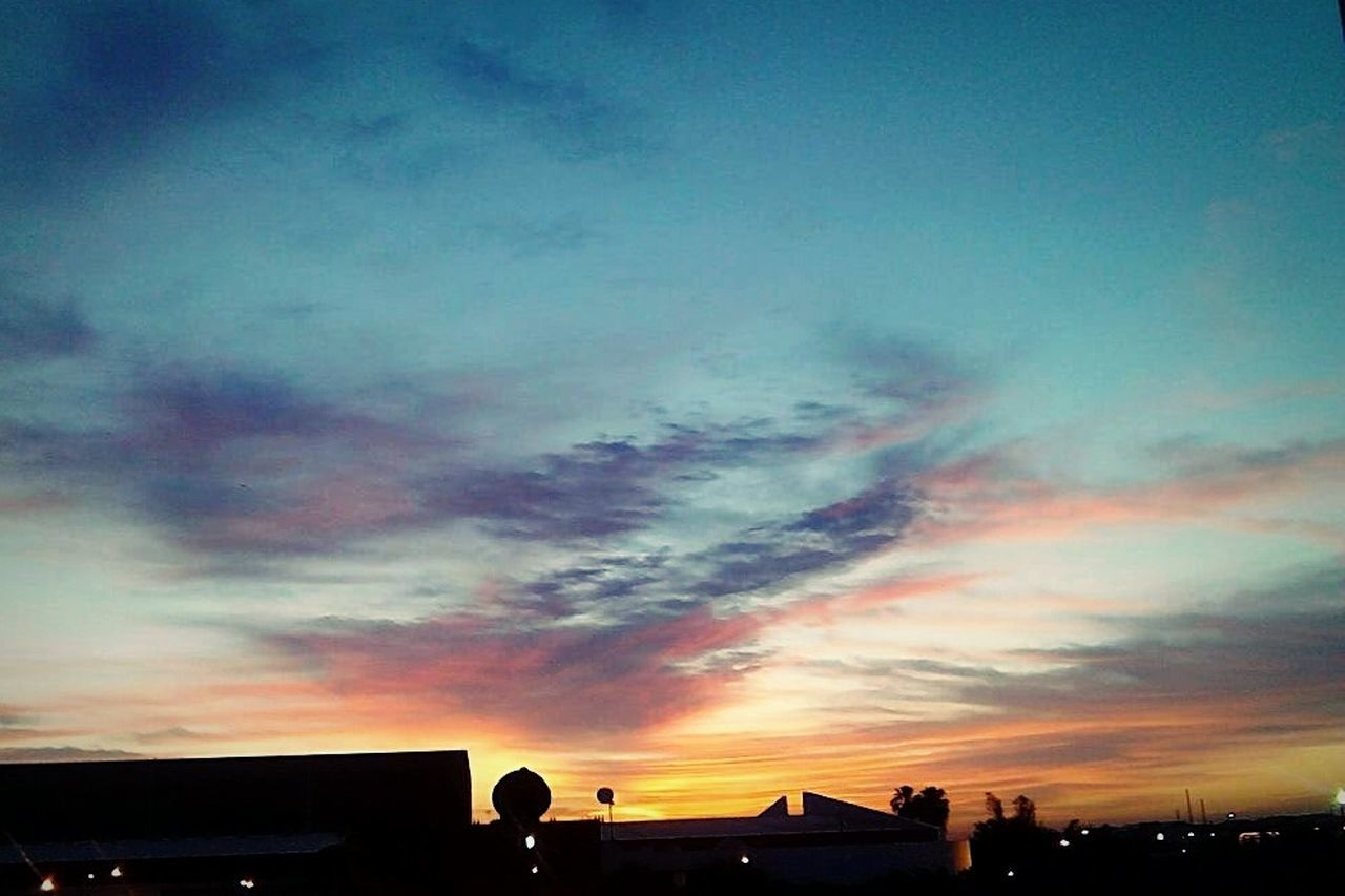 sunset, building exterior, built structure, architecture, sky, silhouette, cloud - sky, dramatic sky, low angle view, house, beauty in nature, nature, no people, outdoors, roof, scenics, city, residential building, multi colored, day