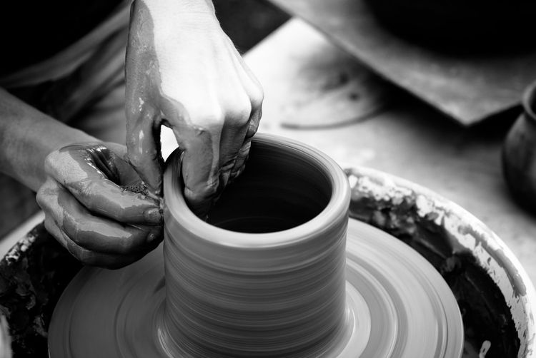 Cropped Image Of Man Making Pottery