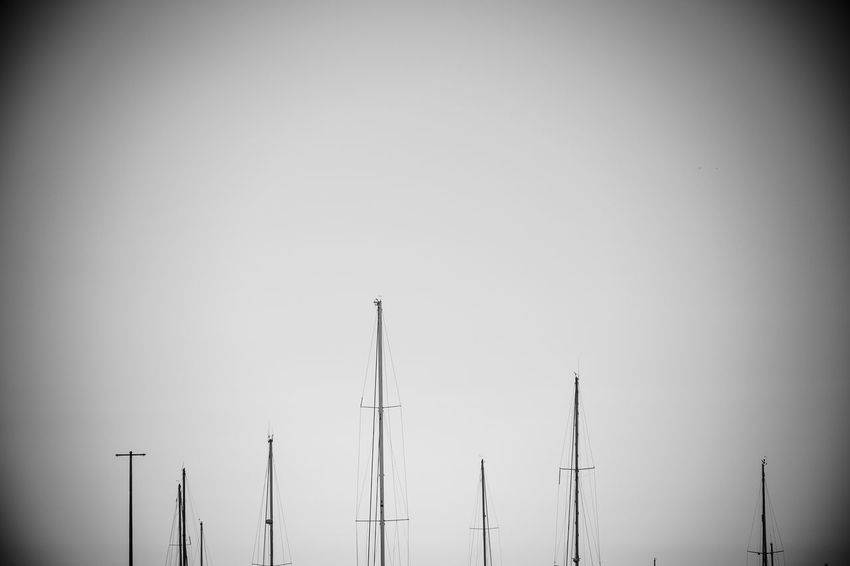 Still no land Boats Clear Sky Day Horizontal Low Angle View Mast Monochrome Photography No People Outdoors Sky