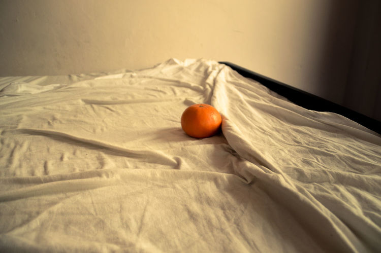 Bed Fruit Healthy Eating Food And Drink Indoors  Food No People Bedroom Freshness Sheet Day Pillow Close-up Blood Orange Conceptual Photography  Morning After Waking Up Alone Orange Color Orange - Fruit