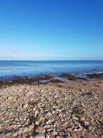 Beach Sea Sand Pebble Nature Horizon Over Water Clear Sky Outdoors Tranquility Sunny Vacations Summer Sky Scenics Water Day Travel Destinations Blue Beauty In Nature No People