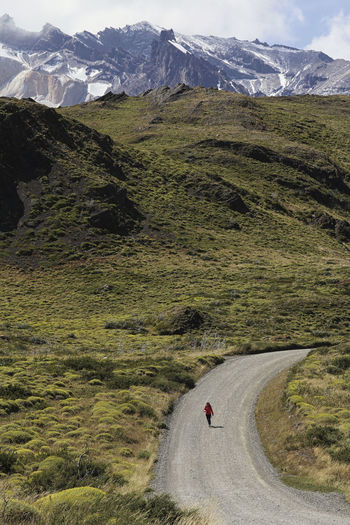 Girl Trekking Adventure Mountain Transportation Landscape Road Beauty In Nature Environment Scenics - Nature Day Nature Travel Grass Mountain Range Plant Non-urban Scene Motion Activity Land Outdoors Riding Walking