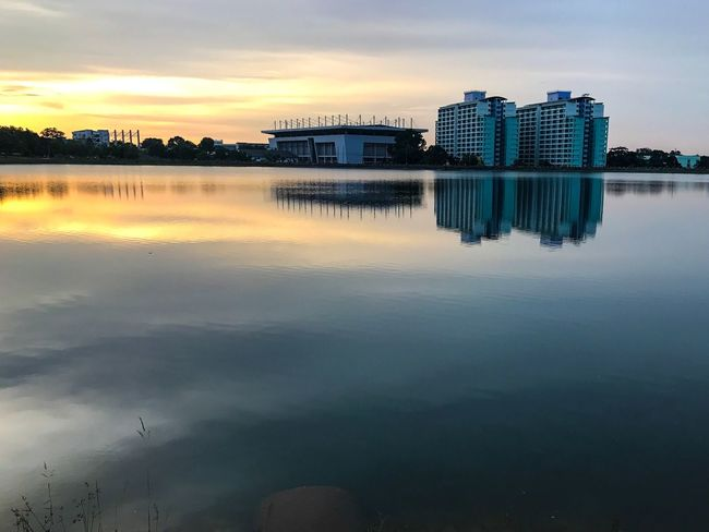 Sunset Sunset Shadow Modern View Reflection Water Building Exterior Built Structure Architecture Sky Building Cloud - Sky Waterfront Standing Water Outdoors Residential District Beauty In Nature Office Building Exterior Nature No People Lake Tranquility Sunset Nature Scenics - Nature Beauty In Nature Reflection Tranquility