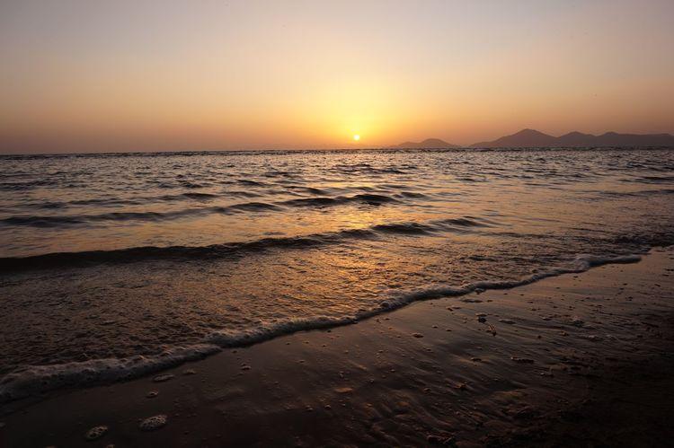 Reflection Water Sand Beach Orange Color Horizon Sea Sunset Nature Horizon Over Water Sunlight Sand No People Sun Sky Wave Outdoors Clear Sky