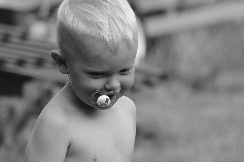 Pacifier Child Childhood One Person Headshot Offspring Portrait Shirtless Focus On Foreground Boys Real People Innocence Males  Close-up Lifestyles Young The Portraitist - 2018 EyeEm Awards 50 Ways Of Seeing: Gratitude Moments Of Happiness 2018 In One Photograph My Best Photo