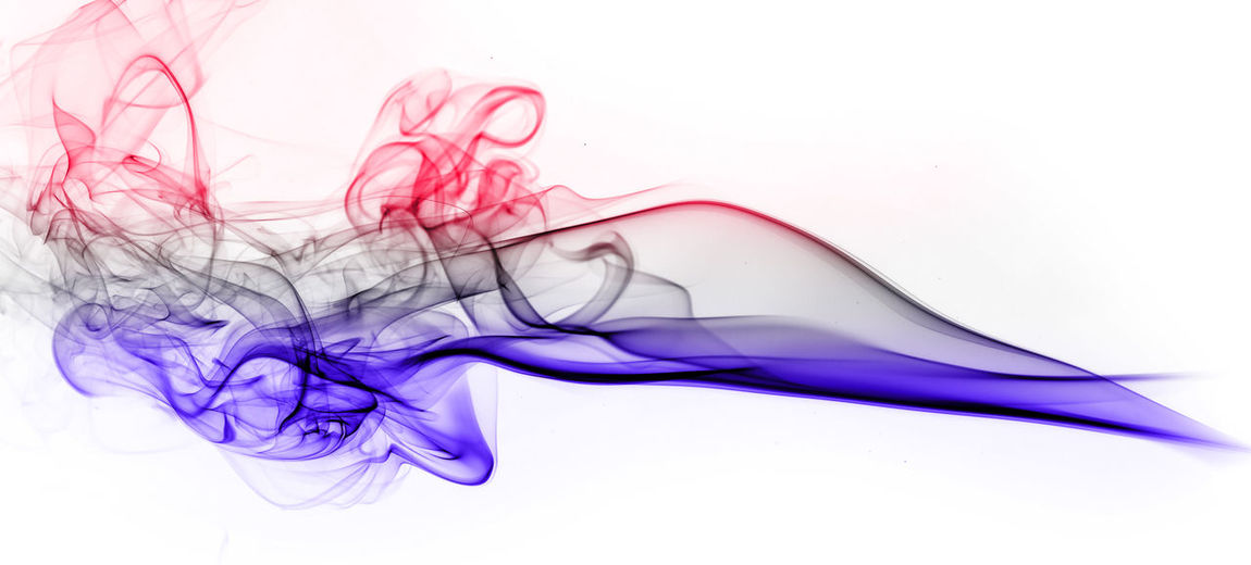 Close-up of colorful smoke against white background