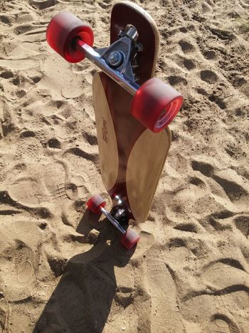 Longboard and sand don't work together... Vacations Sand Sunlight Beach Shadow Holding Child Childhood Low Section Knit Hat Sunny Casual Clothing Tourist Field Day Human Foot Person Rubber Boot Outdoors Personal Perspective