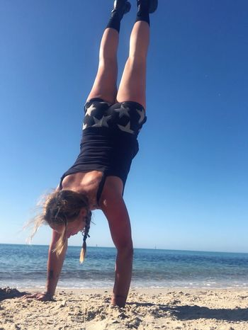 It doesn't matter how old you are, if you keep practicing you will achieve Sea Sky Water Beach Land Horizon One Person Leisure Activity Real People Beauty In Nature Horizon Over Water Clear Sky Sunlight Upside Down Handstand  Women Day