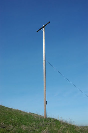 Electricity pole on field