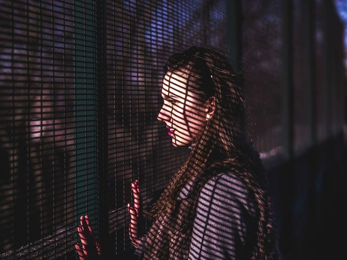 Streetphotography EyeEm Gallery EyeEm Selects Long Hair Woman Portrait Light Light And Shadow Outdoors EyeEm Best Shots Eye4photography  Fence Shadow Shadows & Lights Futuristic Network Security Young Women Focus On Shadow My Best Photo Humanity Meets Technology #NotYourCliche Love Letter