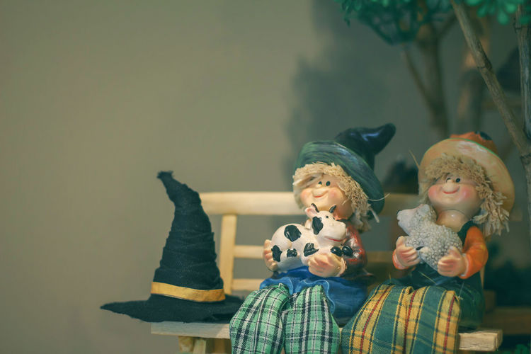 Two women sitting by toys