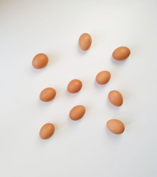 Eggs 1/5 White Background Food No People Large Group Of Objects Close-up Healthy Eating Freshness Egg Healthy Lifestyle Repetition Round Objects Sunnyside Up Protein Hen Egg Dishes Cooking With Eggs Shell Breakfast Fresh Products Studio Shot Hungry Biotin Brown Eggs Benedict Egg White