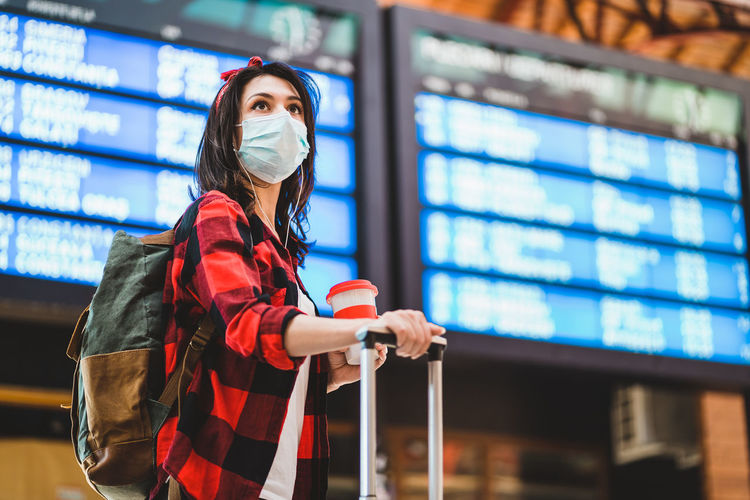 Woman looking at camera while standing on airport