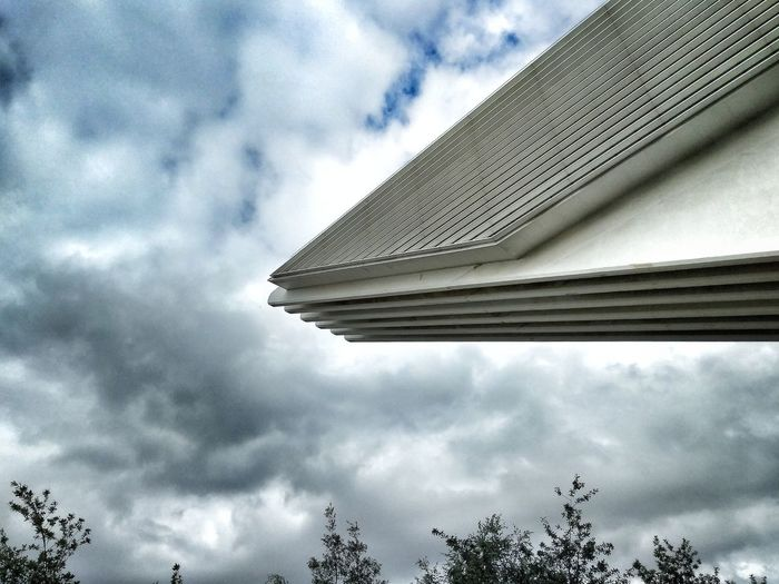 Low angle view of building against clouds