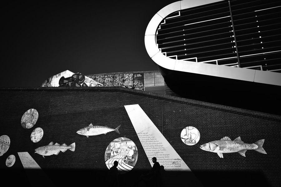 Docklands #1 Architecture Streetphotography Sky Shadows Silhouette Germany Travel Sunlight Fish Shape Monochrome Hamburg Europe Creativity Travel Photography Altona Grafitty Docklands No People High Angle View Mystreetview
