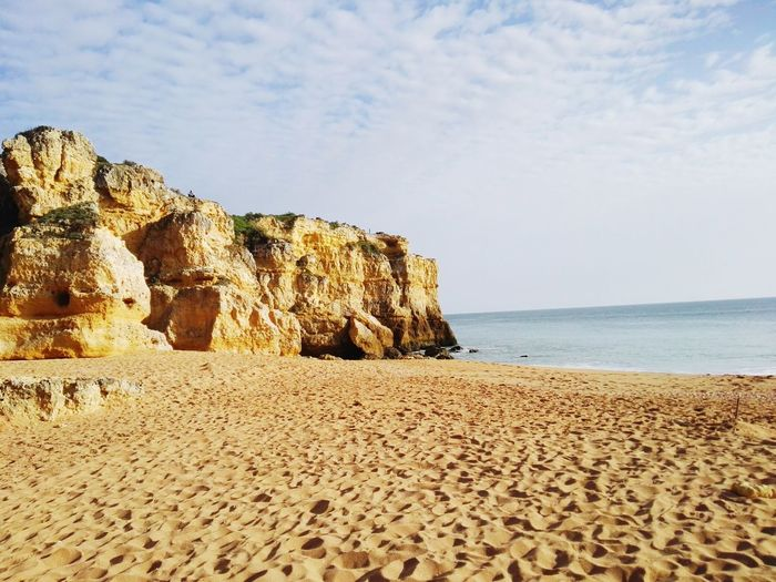 EyeEm Selects Beach Sand Sea Rock - Object Nature Horizon Over Water Summer Beauty In Nature Vacations Sky Outdoors Water No People Scenics Day Algarve Albufeira Beach Photography