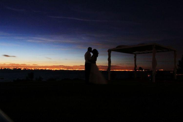 Silhouette man standing against blue sky at dusk