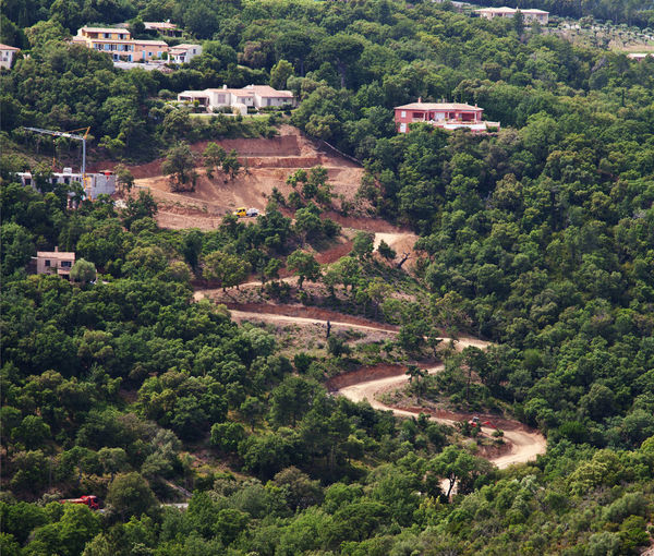 High angle view of road construction amidst trees