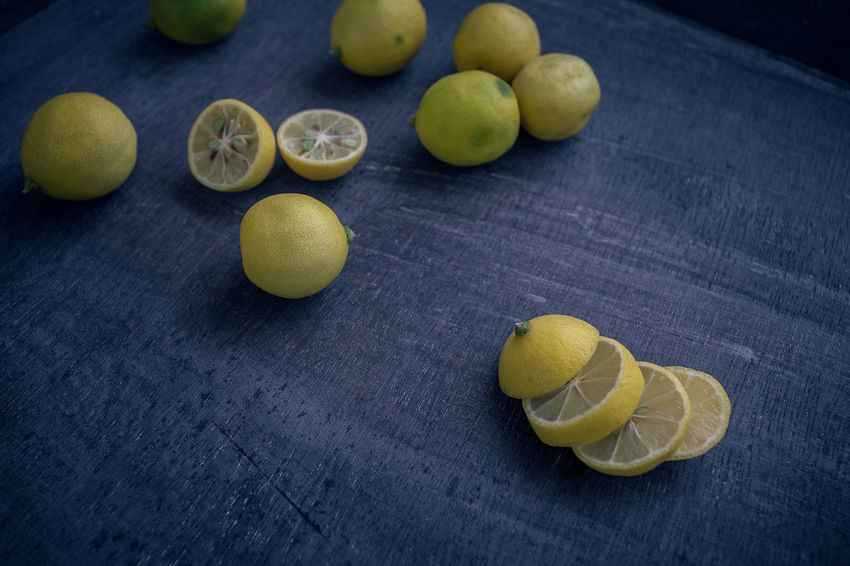Limequats Citrus Fruit Close-up Cross Section Day Food Food And Drink Freshness Fruit Healthy Eating Indoors  Kumquat Kumquats Lemon Lime Limequat No People SLICE Sour Taste Still Life Table Yellow