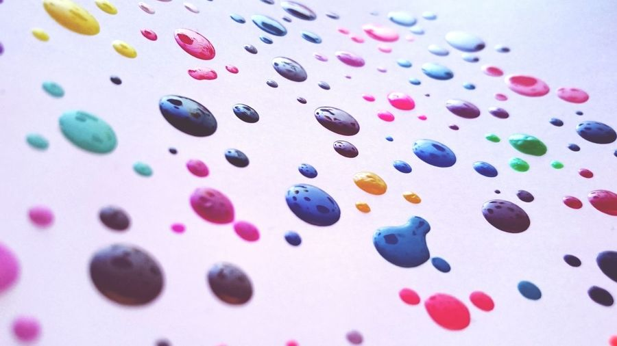 Colorful paints on white table