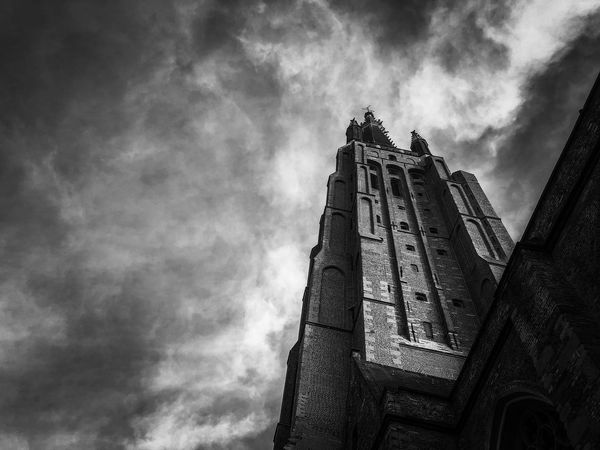 Cloud - Sky Sky Low Angle View Building Exterior Built Structure Architecture Spirituality Belief Building Religion Place Of Worship Nature History No People The Past Old Day Outdoors Gothic Style Ominous Spire