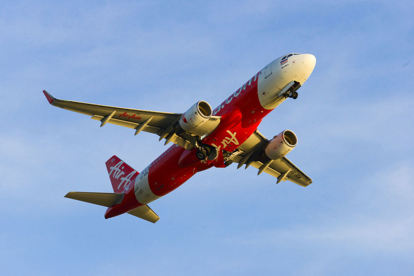 Air Asia Air Vehicle Airplane Clear Sky Day Flying Low Angle View Outdoors Red Sky Speed Transportation