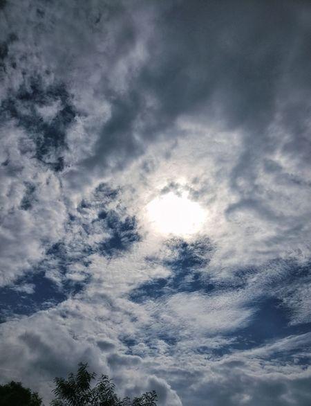 EyeEm Selects Peeking Through What Lies Beyond... Azure Sky Rain Clouds Low Angle View