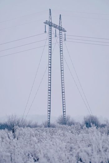 Cable Electricity  Power Line  Power Supply Electricity Pylon Connection No People Fuel And Power Generation Snow Field Outdoors Sky Nature Winter Day Landscape Cold Temperature Technology