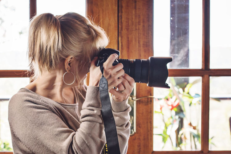 Self Portrait Blond Hair Camera - Photographic Equipment Day Holding Indoors  Leisure Activity Lifestyles One Person Photographer Photographing Photography Themes Real People Self Portrait Selfie Standing Window