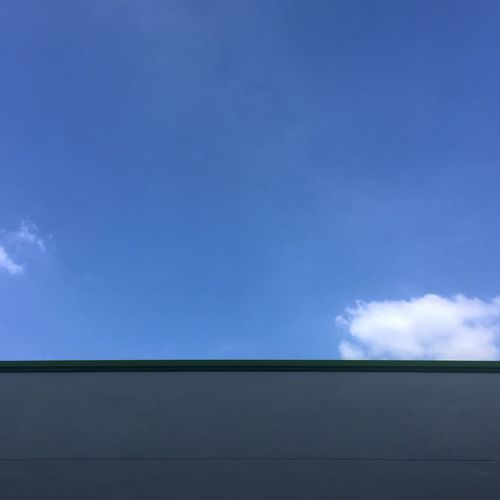 Blue Sky Against A Building Line Blue Low Angle View Sky Outdoors Sunny Day Blue Sky Building Exterior Building And Sky Building Line Graphic Graphical Exterior Blue Sky Exterior Line Simple Composition White Building White Wall Minimal Design Minimal Minimal Composition