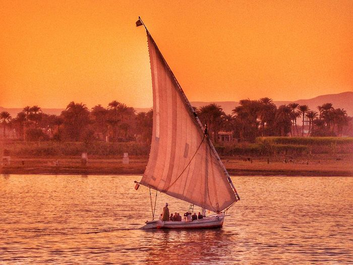 River Nile River Riverview Riverviews Luxor Egypt Yachts Sunset Sunset_collection Sunsets Sunset Silhouettes Orange Sunset Tranquility Felucca Sailing Boat Pink Sunset