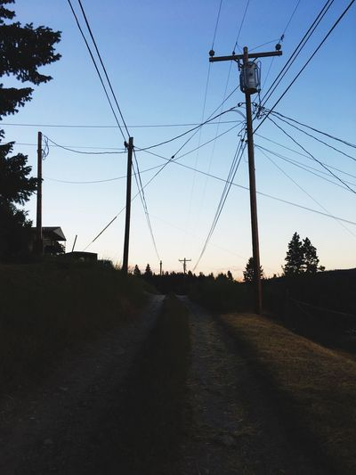 Cable Connection Power Line  Electricity  Power Supply Electricity Pylon Fuel And Power Generation Silhouette No People Sky Telephone Line Sunset Technology Outdoors Transportation Tree Day Nature Clear Sky is