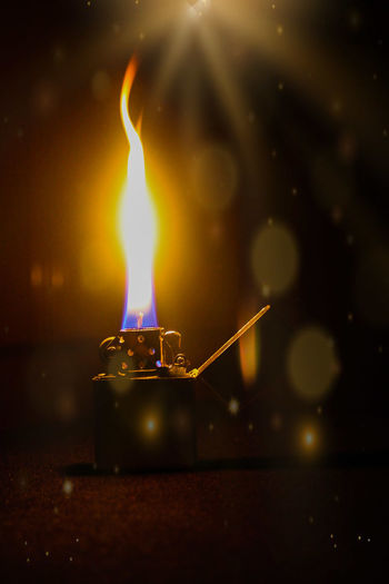 Close-up of cigarette lighter in darkroom