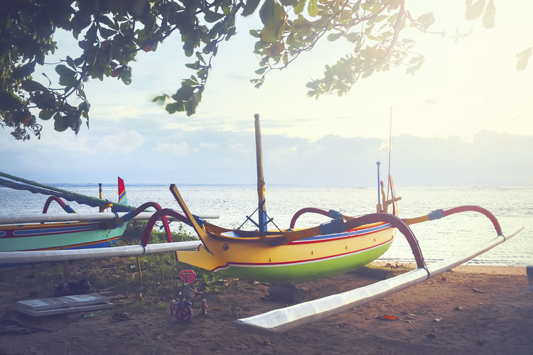 traditional fishing boats at the morning. Sanur Beach, Bali, Indonesia. ASIA Bali INDONESIA Beach Beauty In Nature Boat Boats Day Fisherman Boat Jukung Longtail Boat Mode Of Transport Moored Nature Nautical Vessel Outdoors Outrigger Sanur Beach Scenics Sea Sky Tranquility Transportation Tree Water