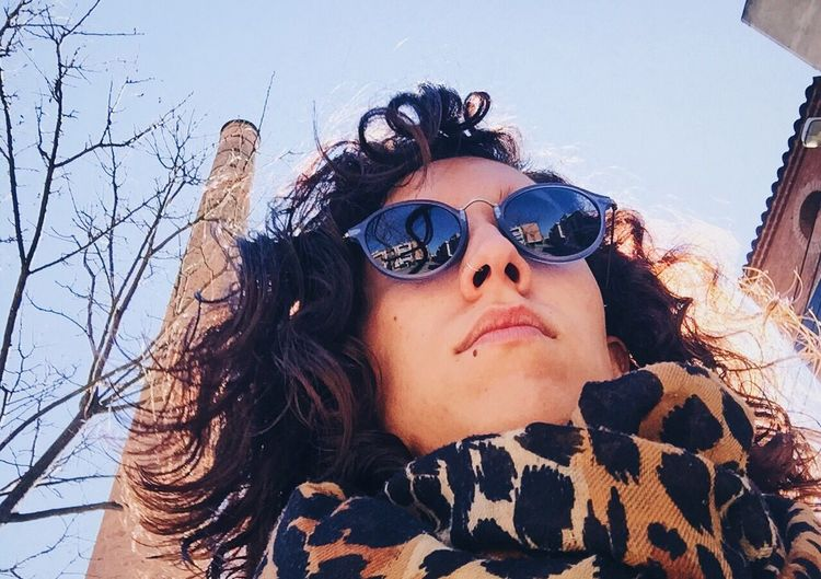 Spring time is almots here 🌸 Sunglasses Young Adult Portrait Women Sky Human Hair Curly Hair Young Women One Person Outdoors Real People IPhoneography Sunny Day Springtime Chimney EyeEmNewHere The Portraitist - 2017 EyeEm Awards