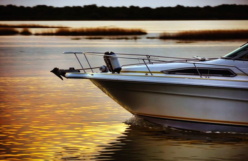 pleasure craft Prow Cruising Lagoon Nautical Vessel Boat Boats Boats⛵️ Boating Sunrise Gold Colored Water Surface Water Nautical Vessel Reflection Sunset Motorboat Marina Floating On Water Rippled Yacht Speedboat Recreational Boat